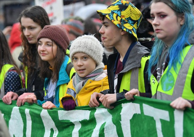 Environmental activist Greta Thunberg (centre) marches during a Youth Strike 4 Climate protest in Bristol.