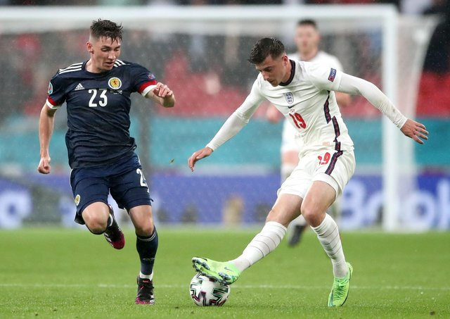 SIDELINED: Scotland's Billy Gilmour (left) and Mason Mount battle for the ball at Wembley on Friday night. Picture: Nick Potts/PA