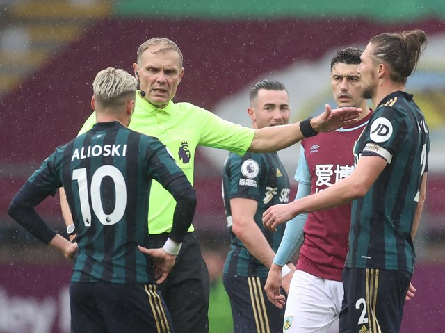 FLASHPOINT: Ezgjan Alioski is spoken to about a gesture at Turf Moor which the authorities have decided was misinterpreted