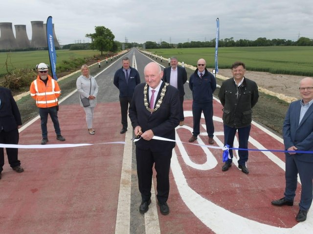 North Yorkshire County Council chair Coun Stuart Martin cuts the ribbon at the reopening of the A19 at Chapel Haddlesey with representatives of the County Council's highways team, Balfour Beatty, the LEP and consultants WSP