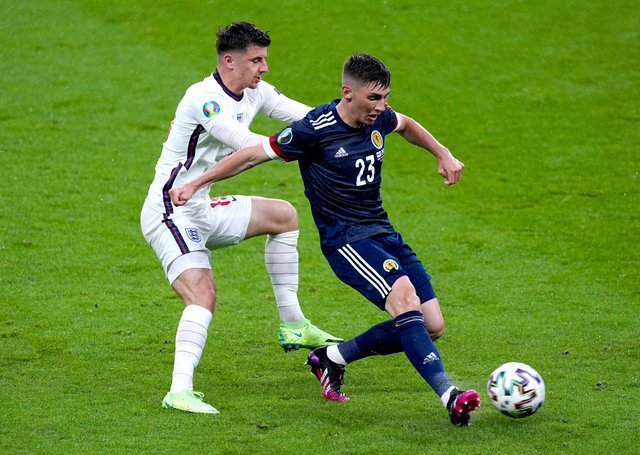 Close contact: England's Mason Mount and Scotland's Billy Gilmour battle for the ball.