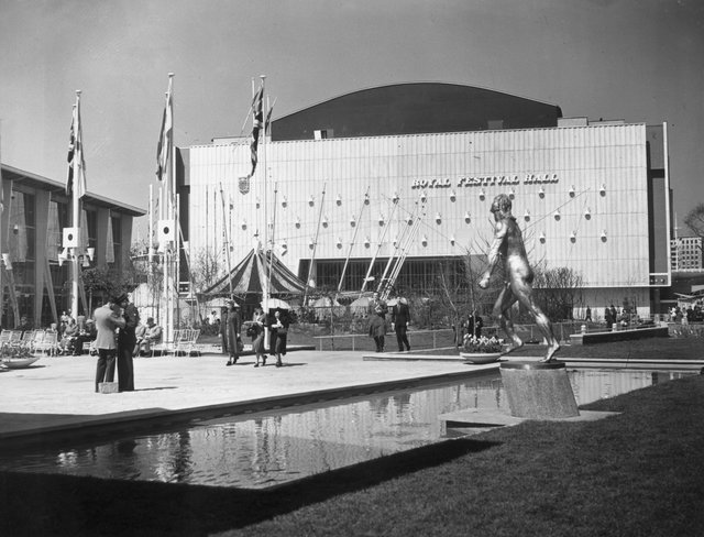 12th May 1951:  Visitors stroll outside the Royal Festival Hall on the South Bank, London during the Festival of Britain..  (Photo by Frank Harrison/Topical Press Agency/Getty Images)