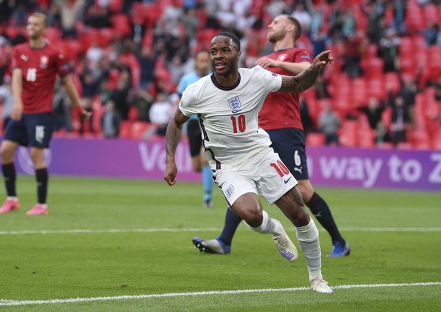 England's Raheem Sterling celebrates after scoring his side's winning goal. (AP Photo/Laurence Griffiths, Pool)