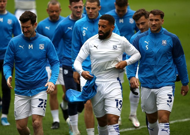 Tranmere Rovers' Liam Feeney (centre), David Nugent and Liam Ridehalgh warming up last season. Picture: PA