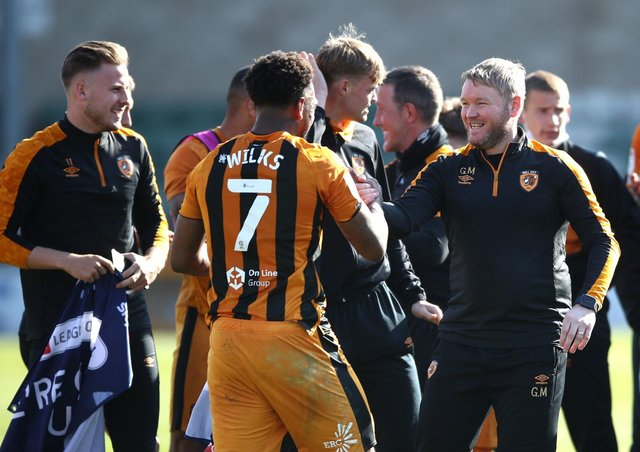 Hull City manager Grant McCann (right) celebrates promotion to the Championship. Picture: Tim Goode/PA