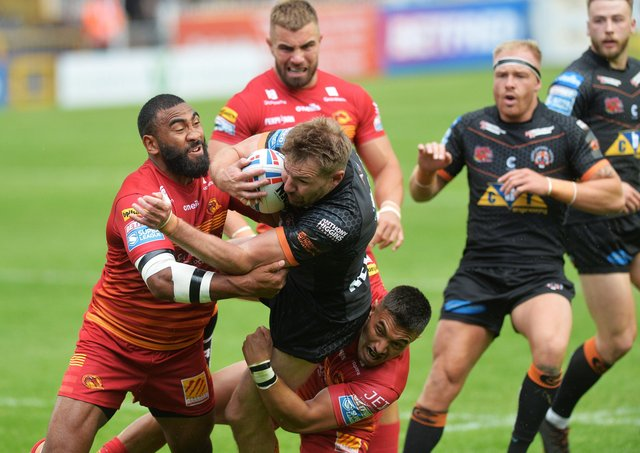 Castleford Tigers' Michael Shenton is stopped by the Catalans defence. Picture: Jonathan Gawthorpe