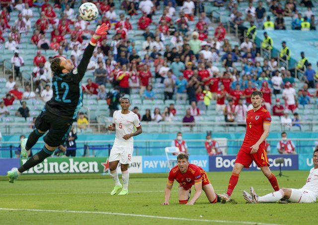 Wales goalkeeper Danny Ward makes a save as Switzerland's Manuel Akanji, Mario Gavranovic and Wales' Chris Mepham and Ben Davies look on. Picture: PA