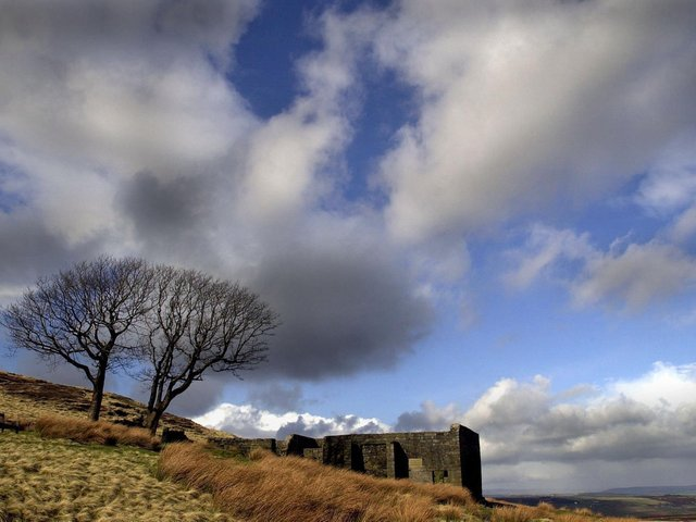 Top Withens high on the Pennine Moors above Haworth, the ruins have long been associated with the Bronte's as the home of the Earnshaw's in Emily Bronte's novel 'Wuthering Heights'. Image by Bruce Rollinson