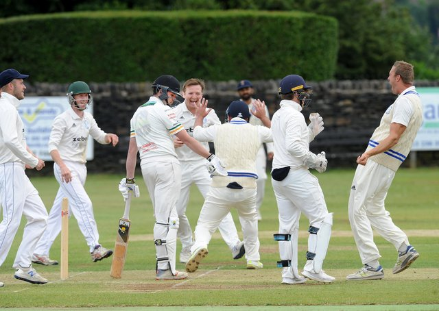Mark Robertshaw of Pudsey St Lawrence surrounded by Farsley players after being caught by Ran Cooper for 0 off the bowling of Mathew Lumb. Picture: Steve Riding