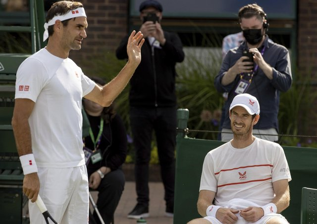 Practice time: Switzerland's Roger Federer, left, and Britain's Andy Murray on Court 14 for a practice session prior to  Wimbledon. (David Gray/Pool via AP)