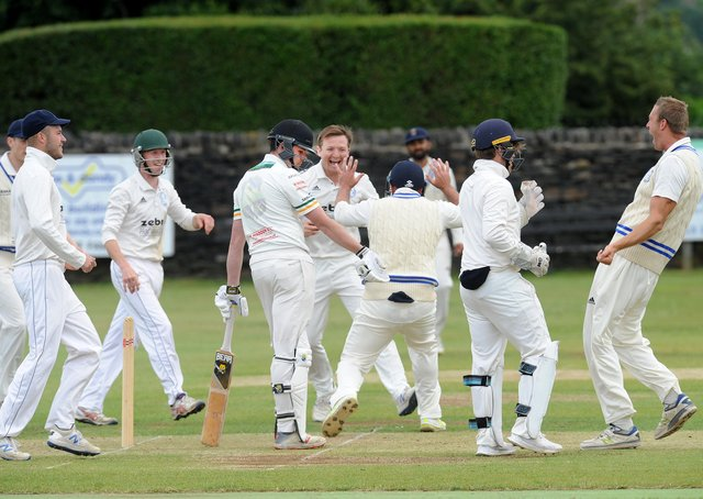 Out: Mark Robertshaw of Pudsey St Lawrence is surrounded by Farsley players after being caught by Ran Cooper for 0 off the bowling of Mathew Lumb in the Bradford League. Pictures: Steve Riding