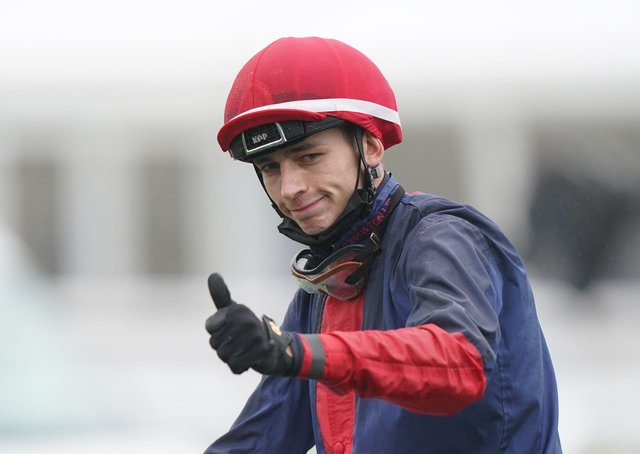 Ben Robinson gestures after winning the William Hill Northumberland Plate Handicap  race on Nicholas T.