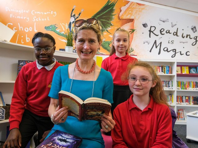 Children's Laureate Crssida Cowell MBE reading with pupils at Dinnington Community Primary School's new library. Picture: Dean Atkins