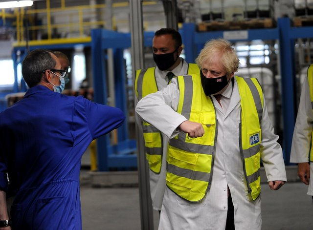 Prime Minister Boris Johnson pictured during his visit to PPG Architectural Coatings, Huddersfield Road, Birstall, West Yorkshire. Picture by Simon Hulme