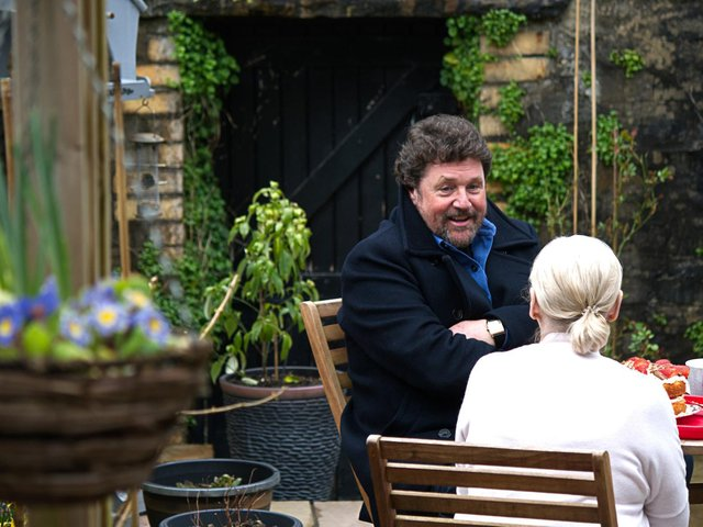 Michael sat in the garden reminiscing with his Auntie Denise over some tea and cakes. Picture: PA Photo/Wildflame Productions.