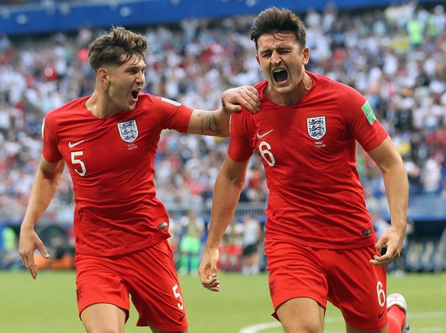 IN TANDEM: John Stones (left) and Harry Maguire excelled alongside Kyle Walker at the 2018 World Cup