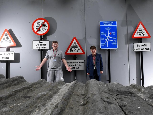Bobby Medlam (left) and Theo Madden are pictured withe signs they designed for The Way Ahead at The Civic in Barnsley. Picture: Simon Hulme.