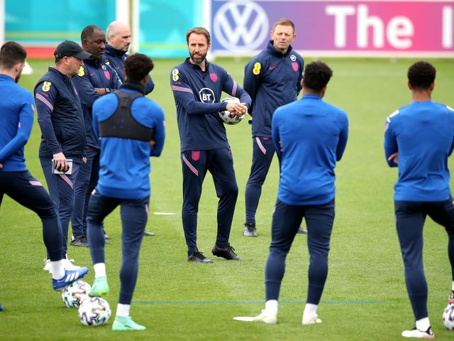 England manager Gareth Southgate speaks to his players during a training session at St George's Park