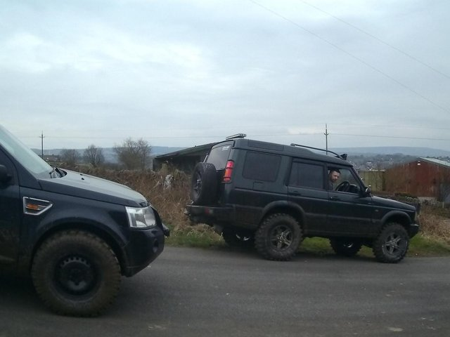 """Drivers of 4x4s on one of the popular """"green lane"""" routes in the Holme Valley exchange words with residents."""
