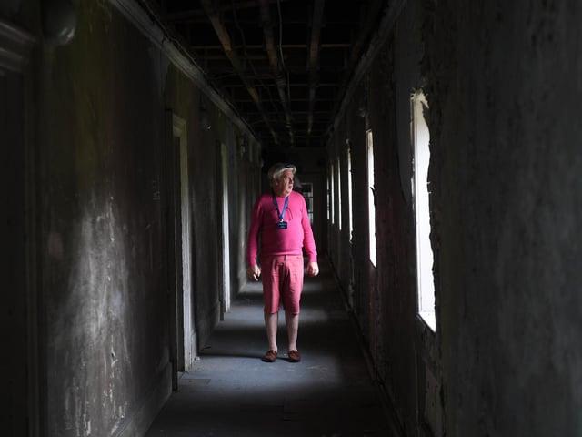 Tour guide David Allott in 'Bedlam', a corridor of bedrooms