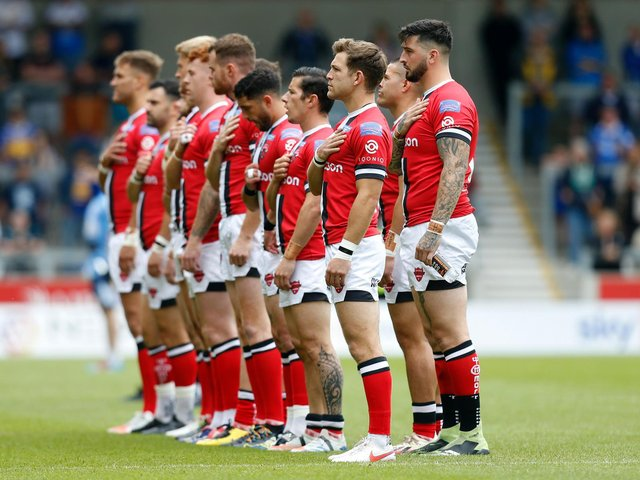 Salford Red Devils players line-up ahead of Sunday's game against Leeds Rhinos. (ED SYKES/SWPIX)