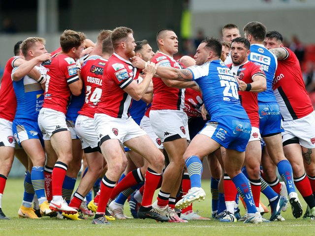Leeds Rhinos' Boidene Thompson launches a punch against Salford Red Devils that led to his suspension. (Ed Sykes/SWpix.com)