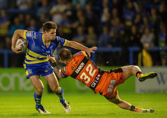 Swapping sides:  Warrington's Jake Mamo, right, in action against his new club Castleford. Picture Bruce Rollinson