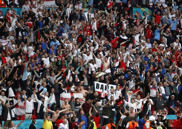 Back in the game: England fans cheer against Germany. Wembley capacities will increase for the semi-finals and final despite Covid-19 fears.