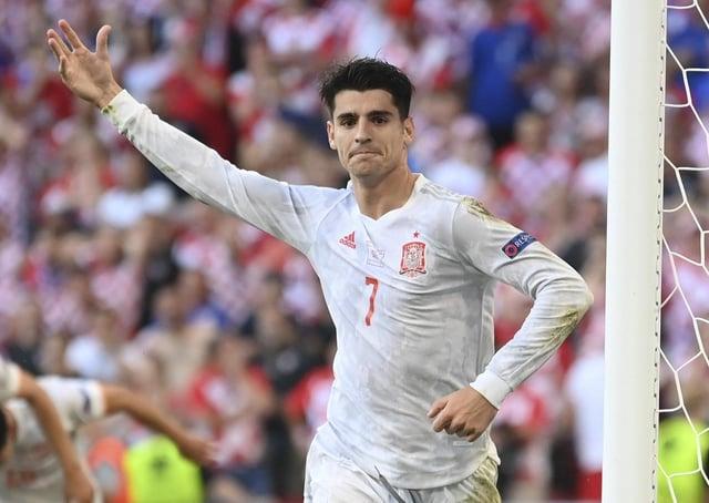 Villain turned hero: Spain's Alvaro Morata celebrates after scoring his side's fourth goal against Croatia.