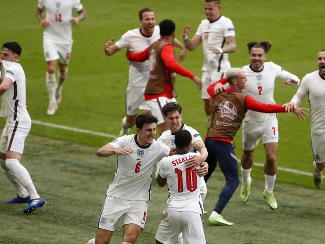 England's Raheem Sterling celebrates with teammates after scoring his side's first goal during the Euro 2020 soccer championship round of 16 match between England and Germany, at Wembley stadium, in London, Tuesday, June 29, 2021. (Matthew Childs/Pool via AP).