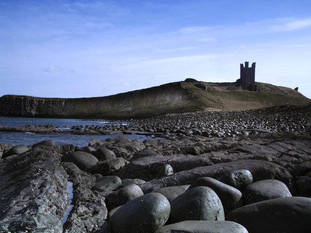 Dunstanburgh Castle by the North Sea in Northumberland, taken from Embleton Bay. Picture by Jane Coltman