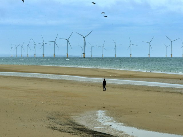 A man walks across the beach in Redcar. Picture: Jonathan Gawthorpe.