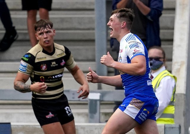 Leeds Rhinos' Jack Broadbent (right) celebrates one of his four tries. Pictures: PA