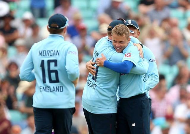 England's Sam Curran (right) celebrates taking the wicket of Sri Lanka's Chamika Karunaratne. Picture: PA.