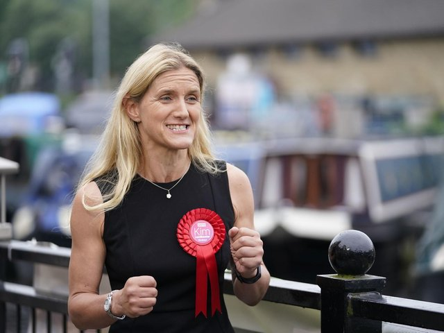 Labour candidate Kim Leadbeater celebrates by a canal in Huddersfield after winning the Batley and Spen by-election