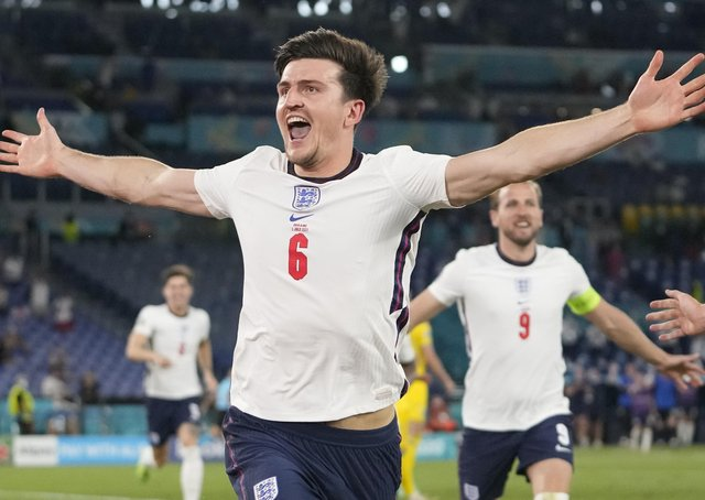 Sheffield-born Harry Maguire wheels away in celebration, with fellow goalscorer Harry Kane in the background, after doubling England's lead with a thumping header in the quarter-final rout of the Ukraine in Rome. (Picture: AP/Alessandra Tarantino)