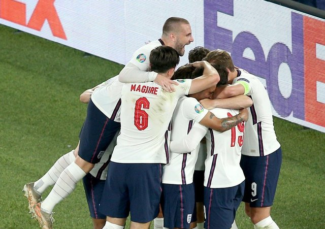 England's Jordan Henderson is mobbed by team-mates after scoring their side's fourth goal of the game (Picture: PA)