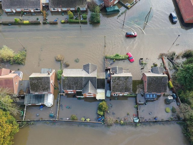 The flood water at Fishlake, in Doncaster, South Yorkshire, as parts of England endured a month's worth of rain in 24 hours in December 2019, with scores of people rescued or forced to evacuate their homes. Picture: Richard McCarthy/PA Wire
