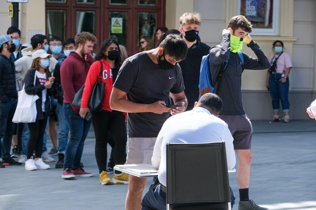Students queue at The Crucible Theatre in Sheffield to get their Covid vaccinations. Picture: Dean Atkins
