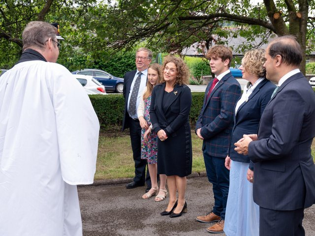 Reverend Dr Jonathan Pritchard (far left) greets relatives of Captain Sir Tom Moore ahead of burying Sir Tom's ashes at his family's grave in Morton Cemetery, Riddlesden