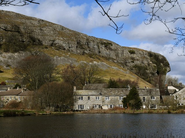 Kilnsey Park fishing lakes overlooked by Kilnsel Crag in the Yorkshire Dales
