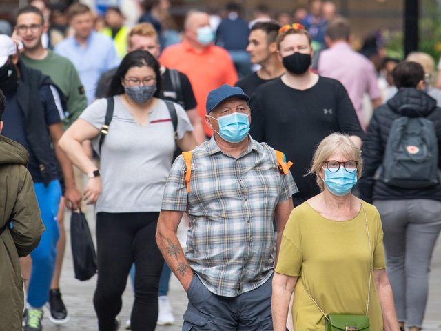 People wearing face masks among crowds of pedestrians in Covent Garden, London. Picture: Dominic Lipinski/PA Wire