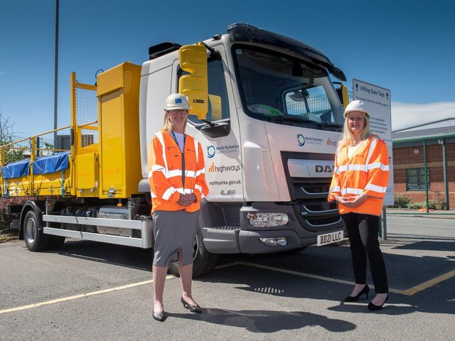 Jayne Charlton (left) and Melisa Burnham in front of a new NY Highways vehicle. The two women are now senior members of North Yorkshire County Council's highways team. (Photo: North Yorkshire County Council)