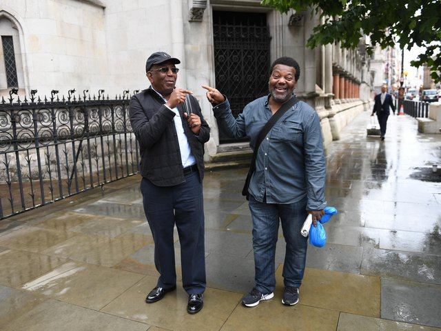 Paul Green (left) and Cleveland Davidson outside the Royal Courts of Justice in London.