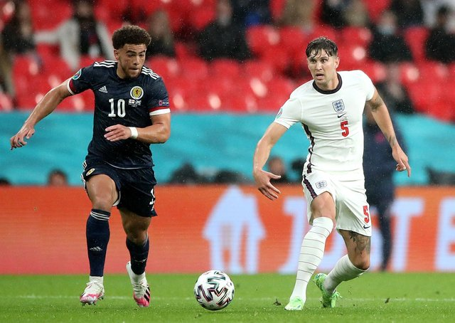 CENTRE STAGE: England's John Stones battles with Scotland's Che Adams during the Euro 2020 Group D match at Wembley. Picture: Nick Potts/PA