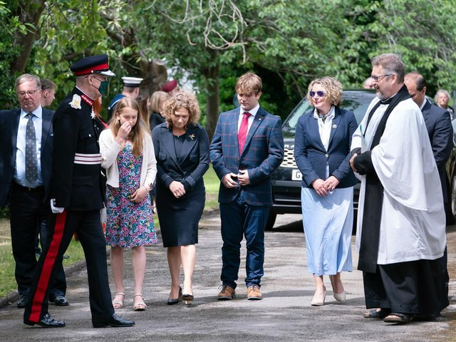 Lord Lieutenant of West Yorkshire Ed Anderson (second left) and Reverend Dr Jonathan Pritchard (right), greet relatives of Captain Sir Tom Moore