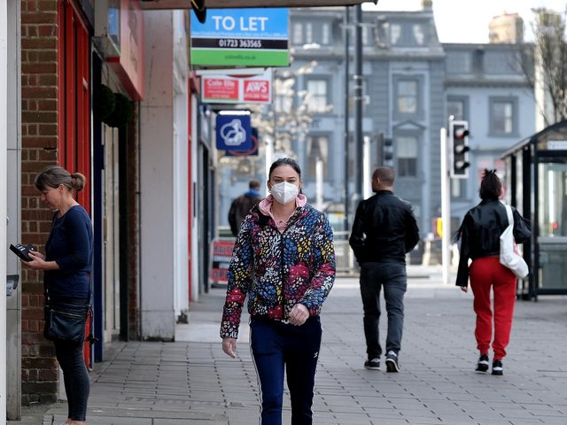 A woman wears a face mask in Scarborough. Picture: Richard Ponter.