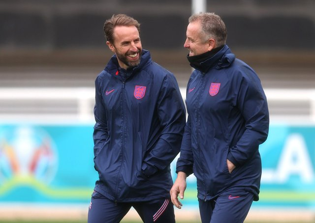 England manager Gareth Southgate and goalkeeping coach Martyn Margetson talk during training at St George's Park. (Photo by Catherine Ivill/Getty Images)