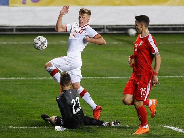 DEVELOPING: Leeds United's Mateusz Bogusz, left, pictured in action for Poland's under-21s against Serbia under-21s in the Euro Under-21s qualifier at FK Metalac last October. Photo by Srdjan Stevanovic/Getty Images.