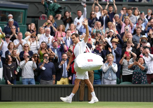 Roger Federer applauds the fans as he leaves the field after defeat to Hubert Hurkacz.